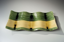 Suzuki Tetsu (b. 1964), Undulating, rectangular platter with carved horizontal linear stripes covered with pooling green and yellow glazes