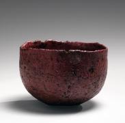Nishihata Tadashi (b. 1948), Round Tamba teabowl with irregular mouth, covered withakadobe(red slip glaze with iron)