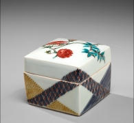 Covered square box with slightly doomed cover, decorated with roses, patterned bands in red, blue and yellow on exterior, patterned triangles in yellow and blue and squares in red and green in the interior of both top and bottom pieces, ca. 1979