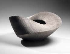 Large twisting, horizontal vessel with banded collar and metal file-impressed surface, 2016