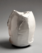 Kaneta Masanao (b. 1953), Rock-like, scooped-out vessel with a multi-planar body, unctuous Hagi white glaze with kiln effects