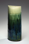 SUZUKI TETSU (b. 1964), Gradated green-glazed tall almond-shaped vessel with four concentric carved bands
