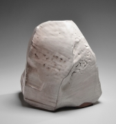 Kaneta Masanao (b. 1953), Rock-like, scooped-out standing vessel with multi-plane body, unctuous Hagi white glaze and kiln effects