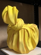 Tanaka YÅ« (b. 1989), Yellow sculpture in the shape of knotted furoshiki (wrapping cloth) enclosing a square box
