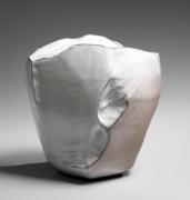 Kaneta Masanao (b. 1953), Rock-like vase with multi-plane body, Hagi glaze and kiln effects in pink and gray