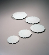 Set of five graduated bluish-white porcelain scalloped-edge plates, 2005