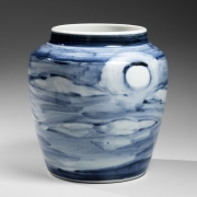 White glazed porcelain vase decorated with a harvest moon in a cloud-filled sky, ca. 1955