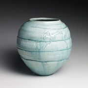 Pale blue-glazed vase with carved concentric bands and two frolicking water sprites, ca. 1958