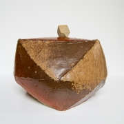 A brown Bizen multi-faceted water jar with filed surface, triangular mouth and base, and a triangular wooden lid with ceramic knob , Early 1990s