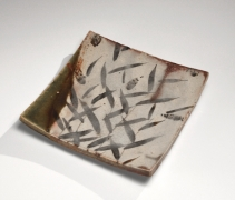 Kitaōji Rosanjin (1883-1959), Mino ware Oribe typesquare, curved platter with reed patterning