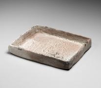Miwa Kyūsetsu XI (Jusetsu) (1910-2012), Crawling, pink, Hagi-glazed low, square plate with slightly flaring sides