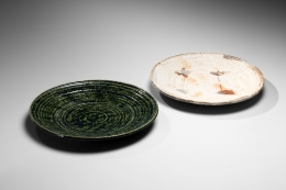 A pair of circular platters, 1 Oribe type, 1 Shino type with iron-oxide leaf patterning, 1960s