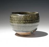 Roundteabowl with pooling dark green ash glaze, 2010