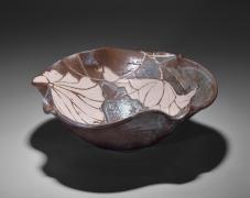 Undulating gray (nezumi) shino type lotus-leaf-shaped bowl with lotus leaf resist-patterning