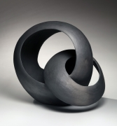 Black sculpture of two interlaced loops, 2018