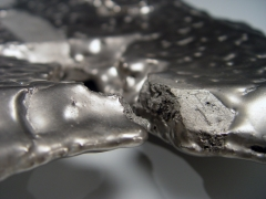 Kakurezaki Ryūichi (b. 1950), Long silver-glazed platter with uneven edges and asymmetrically torn pointed end