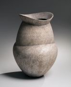 Lobed vessel with flared neck, tapered foot, and striated pattern in silver, 2017