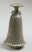 Minegishi Seikō (b. 1952), Eared crackle-glaze celadon swirling bottle with open mouth