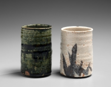 Okabe Mineo (1919-1990), A pair of straight-sided Mino ware teacups: One Oribe type and one Shino type with patterning in iron-oxide