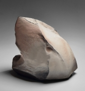 Kaneta Masanao (b. 1953), Rock-like, scooped-out vessel with a multi-planar body, unctuous Hagi glazewith kiln effects
