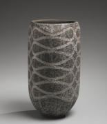 Iguchi Daisuke (b. 1975), Charcoal gray columnar vessel with curving interlaced patterning in silver slip