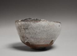 Kaneta Masanao (b. 1953), Round teabowl with irregular mouth, Hagi glaze and extensive kiln effects