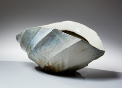 Horizontally elongated, thickly walled Tamba vessel with diagonally faceted surface and pointed ends in thick dripping ash glaze, 2015