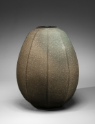 Minegishi Seikō (b. 1952), Faceted tsubo(vessel)withbeishoku(rice-colored) craquelure celadon glaze and kiln effects