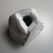 Kaneta Masanao (b. 1953), Rock-like, scooped-out vessel with a multi-planar body, unctuous Hagi white glazewith kiln effects