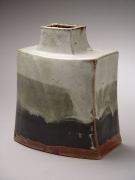 Hamada Shōji (1894-1978), Curved and flattened jar with creamy white, dark grey and black bleeding glazes