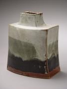 Hamada Shōji (1894-1978), Curved and flattened jar with creamy white, dark grey and black bleeding glazes