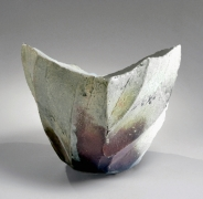 Nishihata Tadashi (b. 1948), Horizontally elongated, thickly walled vessel with pointed ends and diagonally carved bands, covered in dripping Tamba-style ash glaze