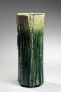 SUZUKI TETSU (b. 1964), Gradated green-glazed faceted vessel six roughly carved, vertical bands