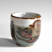 Tamura Kōichi (1918-1987), Celadon and white-glazed teacup, decorated in the design of camellia in copper red and iron black glazes