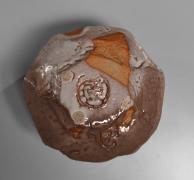 "Kaneta Masanao (b. 1953), Round teabowl with irregular mouth, split foot rim, ""crawling"" Hagi glaze and kiln effects"