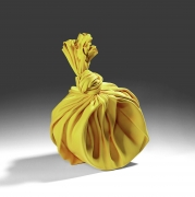 Tanaka YÅ« (b. 1989), Yellow sculpture in the shape of a knotted furoshiki (wrapping cloth) enclosing an open-mouthed vessel