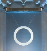 Ring, 2012, lucite, stainless steel cables