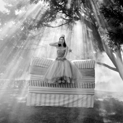 Zoe on Top of Mattress Stack, Snedens Landing, New York, 2007, Archive Number: TSL-0907-009-08, 16 x 20 Silver Gelatin Photograph