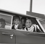 Michael Willis, Harry Williams, and Dwania Kyles sit in the back of a car during the first day of Memphis school integration, 1961, Archival Pigment Print