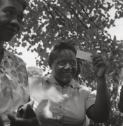 Reecie Hunter Malone displaying her voter registration card, Fayette County, n.d., Archival Pigment Print