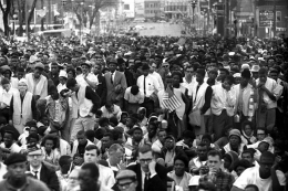 Crowd listening raptly to speech of Dr. Martin Luther King at the foot of State Capital. Selma to Montgomery, Alabama Civil Rights March 25, 1965