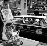 William Edwin Jones pushes daughter Renee Andrewnetta Jones (8 months old) during protest, Main Street, Memphis, Tennessee, ca. 1950's, Archival Pigment Print