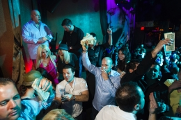 """VIP clubbers prepare to """"make it rain"""" by showering the dance floor with cash at the Las Vegas nightclub Vanity, 2010., 20 x 30 inch - Archival Pigment Print - Ed. of 5"""