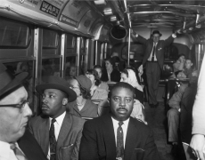 Martin Luther King Jr. and Ralph Abernathy in the front row of a Montgomery, Alabama bus on the day that the city's public transit system was desegregated, n.d., Archival Pigment Print