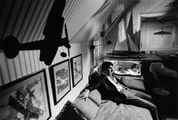 Dustin Hoffman, buzzed by a toy airplane, sits on the set of The Graduate, 1967