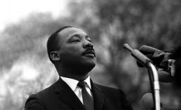Dr. Martin Luther King, Jr. speaking before crowd of 25,000 civil rights marchers, in front of Montgomery, Alabama state capital building. Selma To Montgomery Alabama Civil Rights March, March 25, 1965