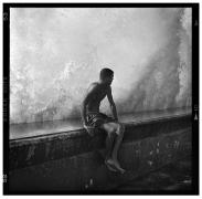 Seated Boy on Malecón Wall, Havana, Cuba, 2012, 20 x 16 inches, Silver Gelatin Photograph, Ed. of 25