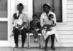 Two mothers with children watching marchers on porch, Selma to Montgomery, Alabama Civil Rights March, March 23-25, 1965