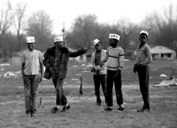 """Young boys with """"UAW"""" (United Auto Workers) paper hats, Selma to Montgomery, Alabama Civil Rights March, March 23-25, 1965"""