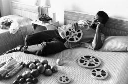 Ali Looking at Film Reels, Miami Beach, FL, 1970, Silver Gelatin Photograph
